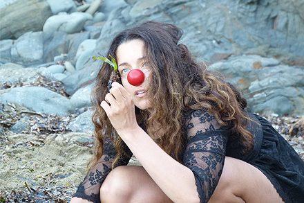 Alicia Gonzalez performing clown research in nature, Menorca, Spain. Photo by Daniela Maiwald.