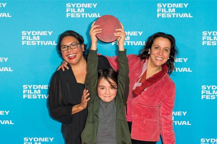 Image: Deborah Mailman, Rachel Perkin's son Arnhem and Rachel Perkins at Sydney Film Festival 2019 Closing Night. Photo courtesy of Sydney Film Festival.